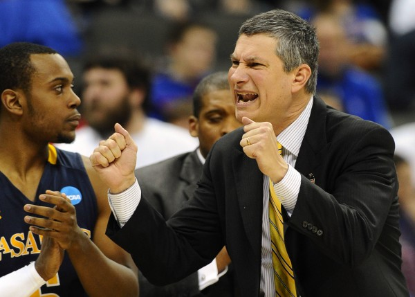 La Salle Explorers head coach John Giannini yells encouragement to his team during La Salle's last-second win over the Mississippi Rebels in the third round of the NCAA men's basketball tourney at the Sprint Center in Kansas City, Mo., March 24, 2013.