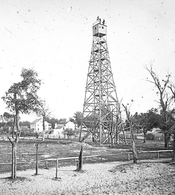 Union soldiers constructed this tall signal tower at Jacksonville, Fla., during the Civil War. From the tower's peak, Signal Corps soldiers can easily flash messages to Navy ships patrolling in the St. Johns River.