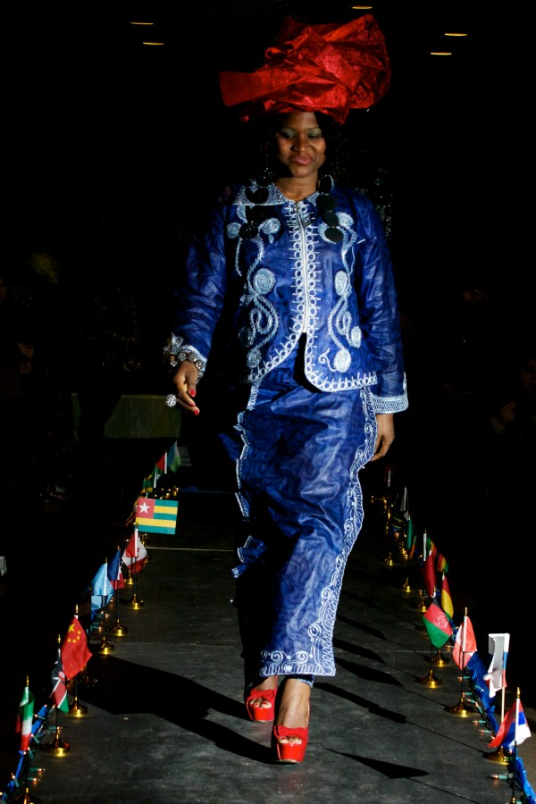 Edwina Caulker walks the runway wearing a handmade dress she bought on a trip back to her homeland of Liberia at the fourth annual International Women's Day Fashion Show in Portland on Friday night.