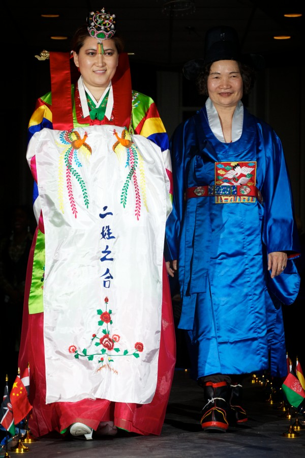 Nayoung Traynham (left) wears a traditional Korean wedding outfit and Yeong-Rae An wears a groom's outfit at the fourth annual International Women's Day Fashion Show in Portland on Friday night. Both are originally from South Korea.