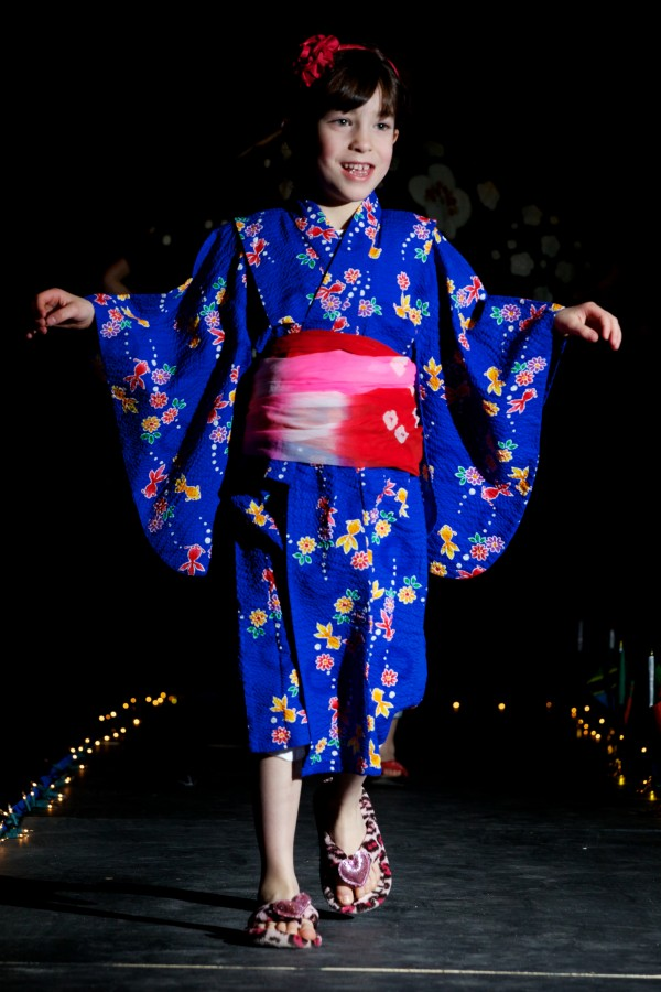 Saya Breiting-Brown, 6, wears a summer outfit from her grandmother's native Japan at the fourth annual International Women's Day Fashion Show in Portland Friday on night.
