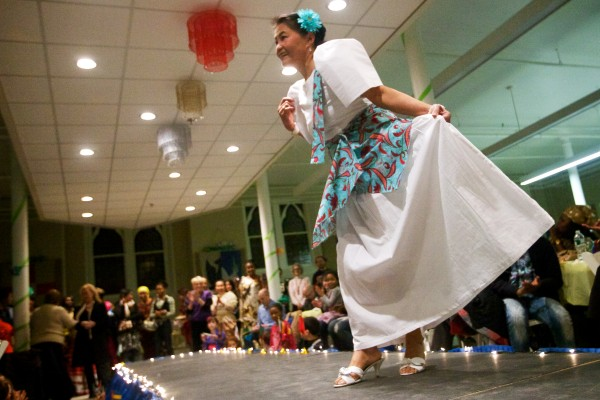 Dolores Atienza Barcebal, who hails originally from the Philippines, curtsies to the crowd at the fourth annual International Women's Day Fashion Show in Portland on Friday night.