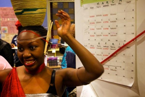 Lydia Bakunda, originally of Barundi, prepares to dance with the Abeza B'Inganzo Troop at the fourth annual International Women's Day Fashion Show in Portland on Friday night.