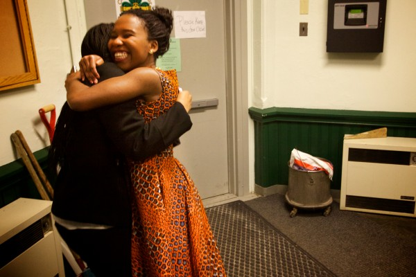Dorcas Thete (right) hugs her friend Christel Batshiondo backstage at the fourth annual International Women's Day Fashion Show in Portland on Friday night. Thete walked the runway wearing a dress her mother, originally from the Democratic Republic of Congo, made for her.
