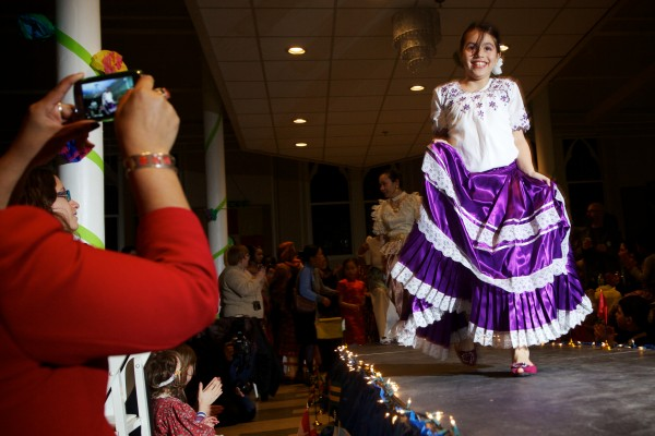 Shawnee Berke, 9, wears a traditional dress from Peru, her mother's homeland, on the runway at the fourth annual International Women's Day Fashion Show in Portland on Friday night.