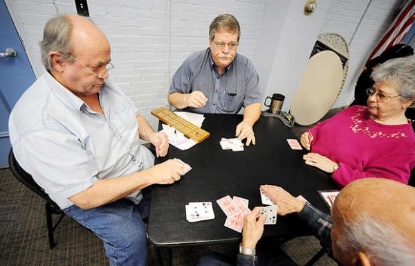 Senior Citizen's Cribbage Club members Don Haley (clockwise from left), Roger Labbe, Betty Ames and Moe Fournier enjoy the card game at the Lewiston Armory Thursday. Haley was dealt his very first 29 hand, the highest possible score, on Feb. 21.