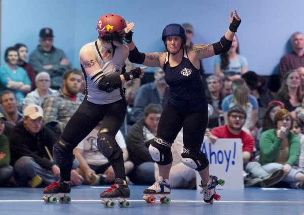 Bristol Smashin' of the Rock Coast Rollers, left, accuses a Port Authority player of a penalty that went uncalled, Saturday, March, 9, 2013, in Portland.