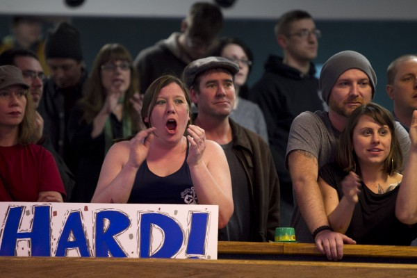 A fan shouts during a bout between the Rock Coast Rollers and the Port Authorities, Saturday, March, 9, 2013, in Portland.