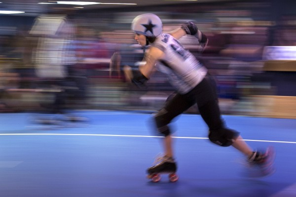 &quotSinner of Gravity,&quot a jammer for the Rock Coast Rollers who has been called &quota centrifugal force to be reckoned with,&quot speeds around the track in a bout against the Port Authorities, Saturday, March, 9, 2013, in Portland.