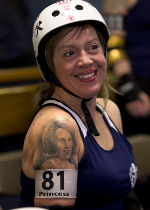Christa Calder, aka &quotPrincess Layher Out,&quot of Auburn, has a tattoo of her mother on her shoulder. &quot[My mother] probably would not approve — so I just bring her along for the ride,' said Calder. &quotI brought my Dad to a bout once and he told me that watching me at roller derby was a lot more fun than watching me do cheerleading competitions in high school.&quot