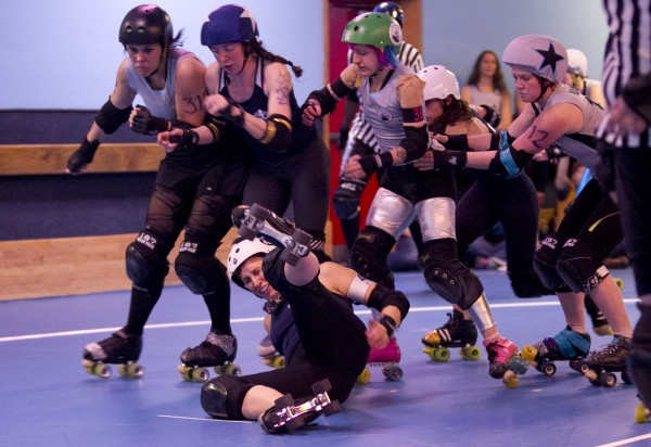 Tracy Fredricks MacMillan, aka &quotT-Storm&quot of the Port Authorities goes down hard in front of the pack in a bout against the Rock Coast Rollers, Saturday, March, 9, 2013, in Portland.