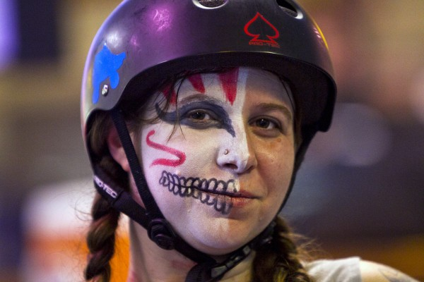 Rock Coast Roller Erin Darnell, aka &quotIron Orchid,&quot of Rockland, wears war paint for a bout against the Port Authorities, Saturday, March, 9, 2013, in Portland. &quotI wear it because it gives me strength and power when I need it most,&quot she said.
