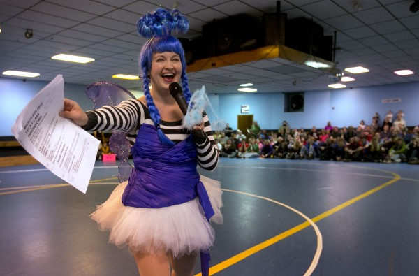 Jennifer Kruszeweski, whose roller derby name is &quotPixie,&quot makes announcements prior to a bout Saturday, March, 9, 2013, in Portland.