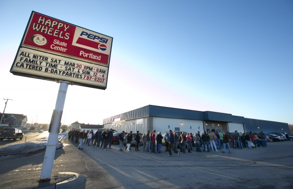 A line of fans stretches around the Happy Wheels roller rink before a bout between the Port Authorities and the Rock Coast Rollers, Saturday, March, 9, 2013, in Portland.