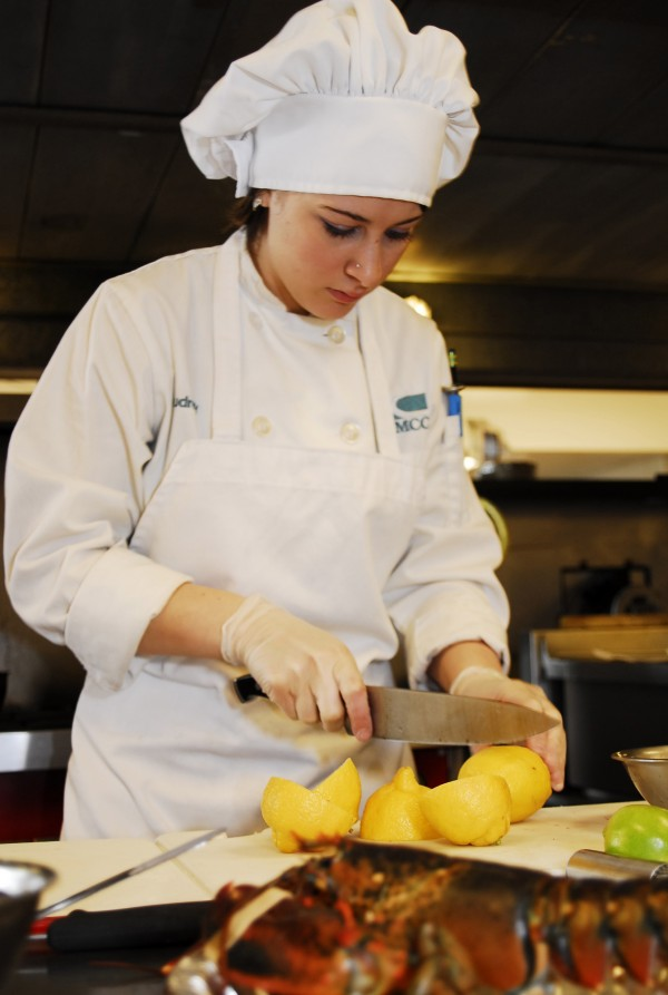 SMCC student Audrey Carlson slices lemons as she prepares her dish for the regional competition of the Jeunes Chefs Rotisseur Competition, held at SMCC on March 10.