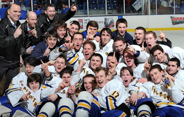 Falmouth players and coaches celebrate after beating Lewiston 4-0 in Saturday night's Class A State Championship hockey game at the Androscoggin Bank Colisee in Lewiston.