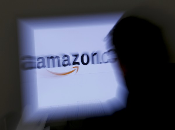 A zoomed illustration image of a man looking at a computer monitor showing the logo of Amazon is seen Nov. 26, 2012.