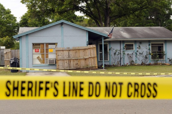 Police tape surrounds a home where a sinkhole opened up and swallowed a man in Seffner, Fla., March 1, 2013. The 36-year-old Florida man was feared dead on Friday after the sinkhole suddenly opened beneath the bedroom of his suburban Tampa home, swallowing him, police and fire officials said.