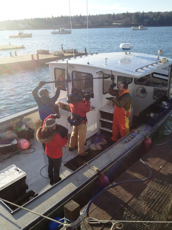A television crew from the Colbert Report show films a segment recently with Southwest Harbor fisherman Andy Mays about two buckets of scallops guts that Mays misplaced last November.