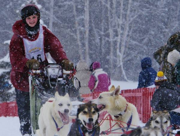 Fredericka Hibbs, 14, crosses the finish line Saturday afternoon at the Can-Am Crown International Sled Dog 30-mile sled dog race in Fort Kent. Hibbs, the daughter of four-time Can-Am Crown International 250-mile sled dog race winner Don Hibbs of Millinocket, completed the race in 3:29:55 for fifth place.