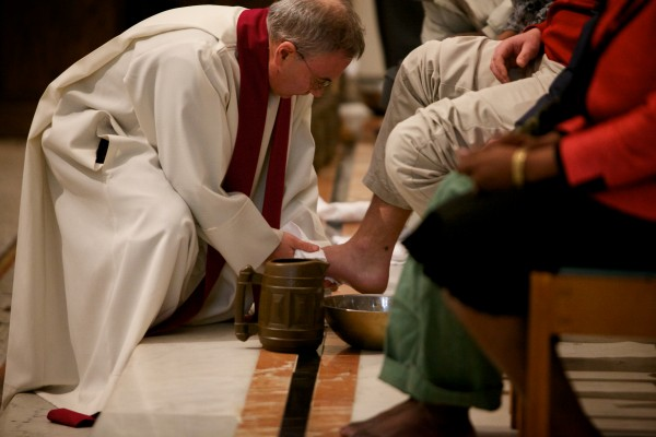 Rev. Michael Seavey washes feet at the Cathedral of the Immaculate Conception in Portland on Thursday. The service aimed to raise awareness of suffering in the community.