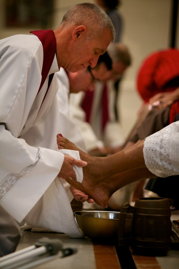 Rev. Louis Phillips washes feet at the Cathedral of the Immaculate Conception in Portland on Thursday. The service aimed to raise awareness of suffering in the community.