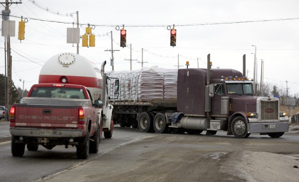 Trucks drive through the intersection of Odlin Road and Coldbrook Road Wednesday afternoon in Hermon. Hermon Town Manager Roger Raymond says that Hermon stands to become the hardest-hit town in Maine by LePage's excise tax plan.