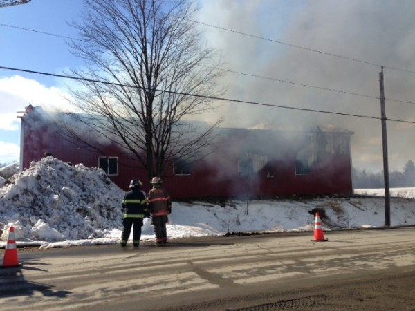 Fire crews fight a barn blaze in Corinna Thursday, March 21, 2013.