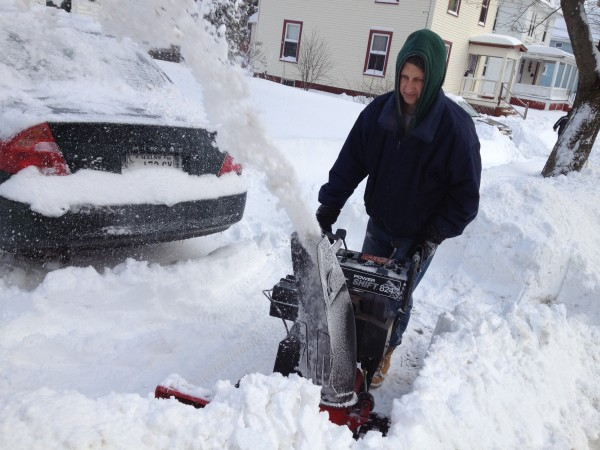 Bruce Worcester snow-blows his driveway on Third Street Wednesday morning after a storm dropped more than a foot of snow in Bangor.