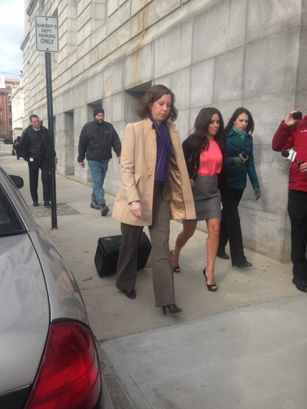 Alexis Wright, in salmon-colored blouse, with attorney Sarah Churchill (left), arrives Friday morning for plea talks at Cumberland County Superior Court in Portland, Maine.