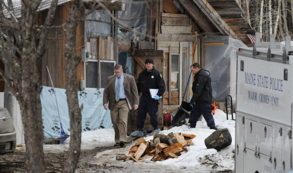 State police evidence techs and a detective walk along a narrow path on the property of Lawrence Lewis at 450 Macwahoc Road in Molunkus on Tuesday. Lewis was found dead inside his home shortly after Bruce King held police at bay with a gun to his head on Monday, March 11, 2013 along Interstate 95 near Lincoln.