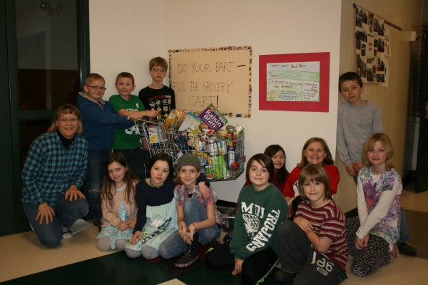 Third-graders at Pemetic Elementary School participate in the food drive.