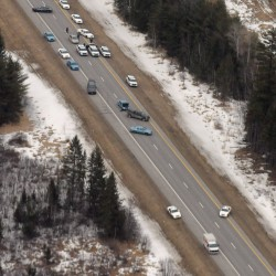 Police stopped a U-Haul van (bottom) in the southbound lane of Interstate 95 about four miles south of the Lincoln exit on Monday. The interstate was closed in both directions Monday afternoon. According to Maine Department of Public Safety spokesman Stephen McCausland, a man in the van was holding a gun to his head.