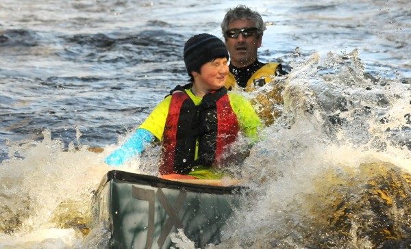 Caellen (left) and Weber Roberts react as their boat makes it through a difficult section during the 34th annual St. George River canoe race Saturday.