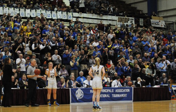 Washburn's Mackenzie Worcester gets a standing ovation for her 1,000th point during Washburn's game against Richmond during class D state championship action on Saturday at the Bangor Auditorium.