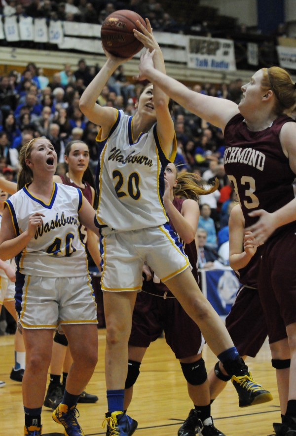 Washburn's Olivia Doody takes the ball up for a shot  against Richmond's Alyssa Pearson during Class D state championship action on Saturday at the Bangor Auditorium. Washburn's Nicole Olson stands ready for the rebound.