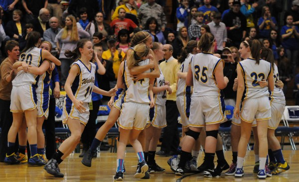 Washburn's girls basketball team celebrates its victory over Richmond 75-55 during class D state championship action on Saturday at the Bangor Auditorium.