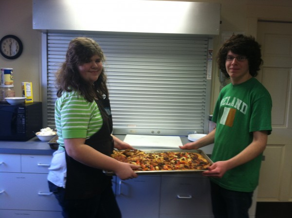 Students Kat Howarth and Takoda Peasley are ready to serve their handmade pizza at the St. Peter's soup kitchen on Saturday, March 9th.