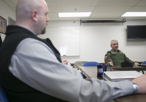 Detective Derek Dinsmore, left, of the Orono Police Department and Sgt. Ron Dunham of Maine Warden Service discuss the problems with the Chickenfest party that typically happens in late April in the area.