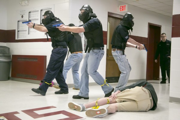 Husson University criminal justice students went through live shooting scenarios at Orono High School on Saturday.