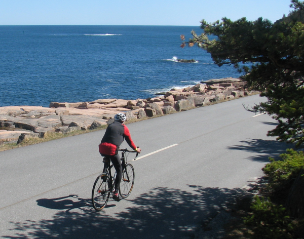 A bicyclist takes advantage of sunny weather on Wednesday, April 17, 2013, to pedal down the Park Loop Road in Acadia National Park.