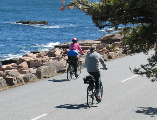 Bicyclists take advantage of sunny weather on Wednesday, April 17, 2013, to pedal down the Park Loop Road in Acadia National Park.