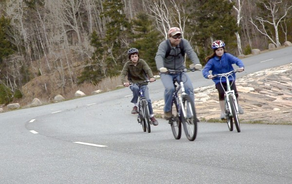 Patrick Watson (center) rides bikes with his two children on the Park Loop Road in Acadia National Park on Thursday, April 18, 2013.