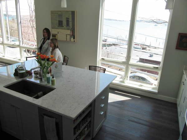 Portland Kitchen Tour organizers Marcy Boynton and Lana Wescott chat in the East End kitchen, overlooking Portland Harbor, of Pam and Peter Macomber. The Macombers' kitchen, part of a new home built by CSI Builders, will be one of the stops on the tour, which is scheduled to take place Mothers' Day weekend.