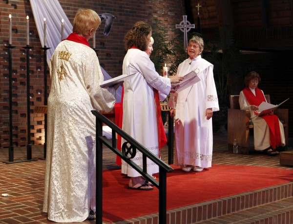 Rosemarie Smead (second from right), a 70-year-old Kentucky woman, is ordained a Roman Catholic priest during a Celebration of Ordination at St. Andrew's United Church of Christ in Louisville, Ky., on Saturday. Smead was ordained as part of a dissident group operating outside official Roman Catholic Church authority.