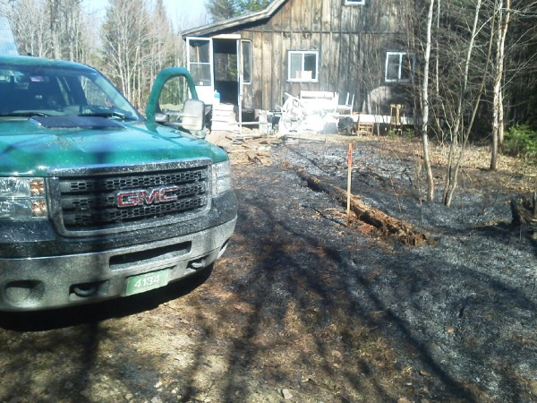 Firefighters from Sangerville reportedly saved a home from an approaching wildfire on Friday.