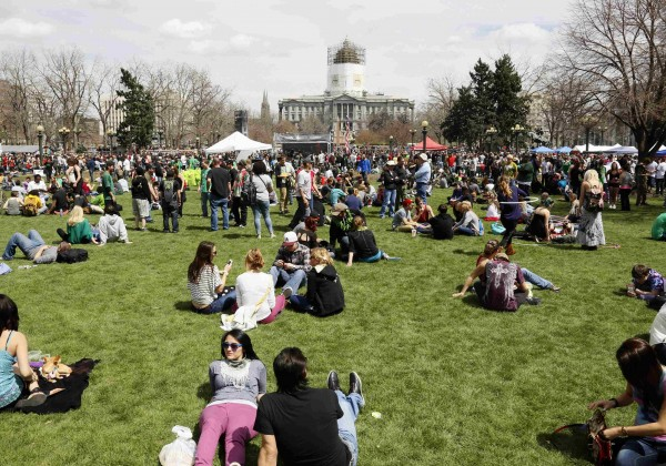 People gather at the 4/20 pro-marijuana rally in Civic Center Park with the capitol building in the background in downtown Denver on Saturday.