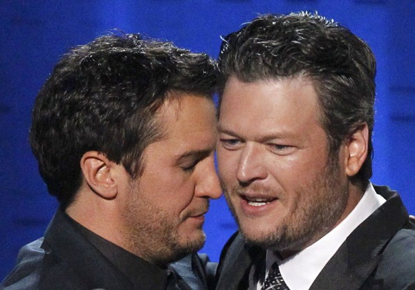 Luke Bryan (left) is congratulated by Blake Shelton after winning the award for entertainer of the year at the 48th ACM Awards in Las Vegas on Sunday.