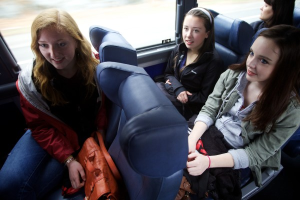 Adley Palreiro (from left) Rose Lacouture and Veronica Sullivan of York High School ride a bus to Fenway Park on Saturday during a trip with Volunteers of America.