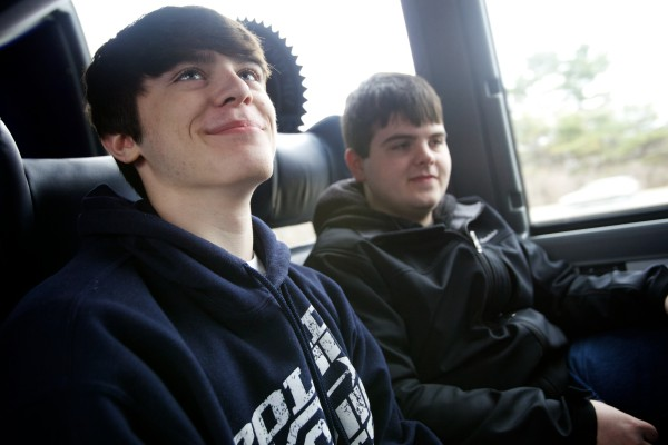Brothers Joe (left) and Matt Principe of Poland Regional High School ride a bus to Fenway Park on Saturday on a reward trip with Volunteers of America.